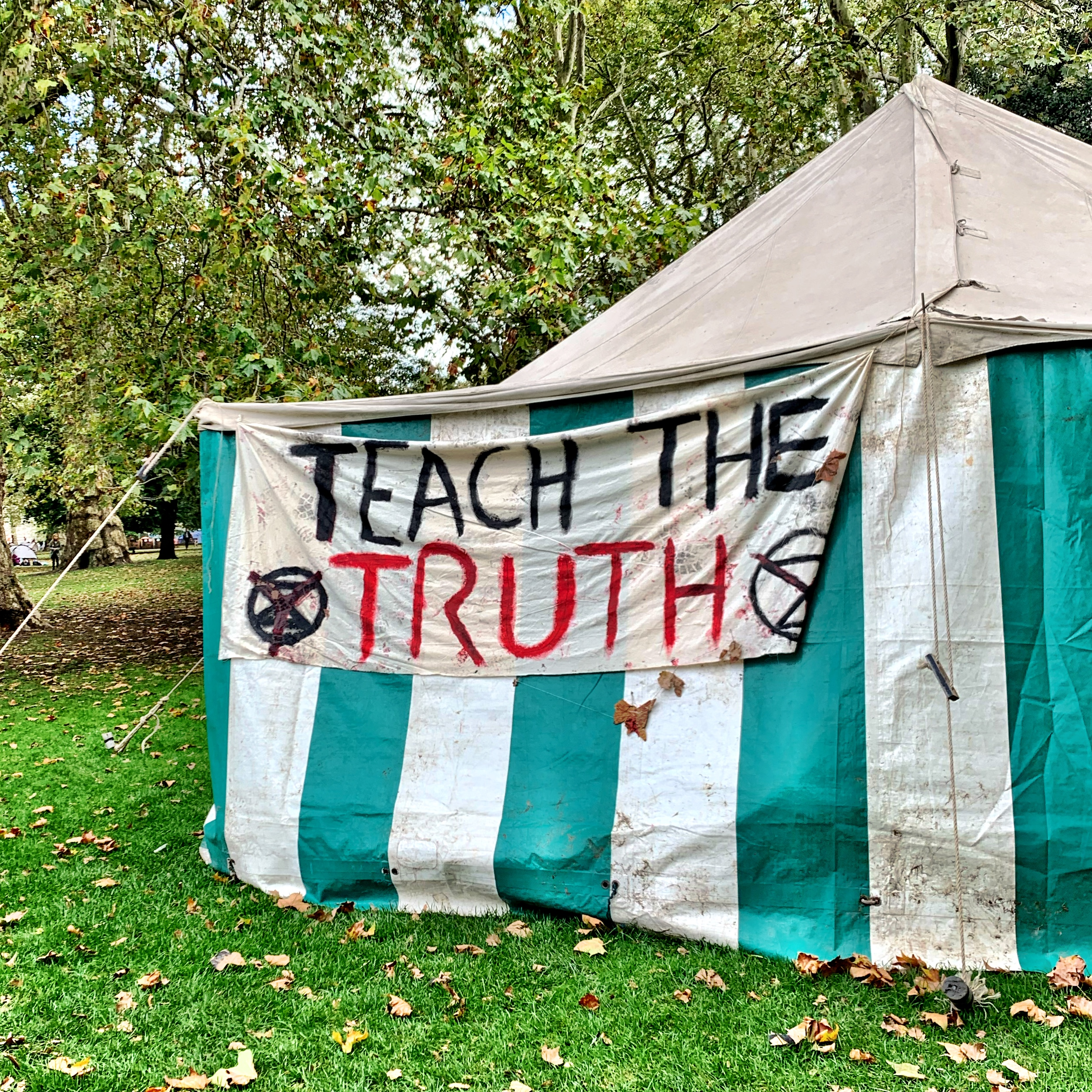 "An Extinction Rebellion tent displaying a banner which reads ""Teach the Truth"""